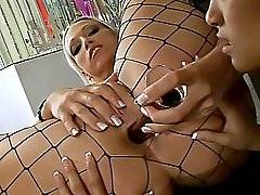 Daisy spreads Nikki Hunter's fishnet covered legs open wide to fill her ass with her dildo.Nikki Hunter, Daisy