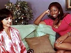 Ebony beauty Candace Von seduces hot brunette before getting her pussy licked and fingered