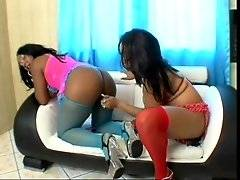 Ebony chick makes her sista suck toy and presses it in her chocolate pussy.